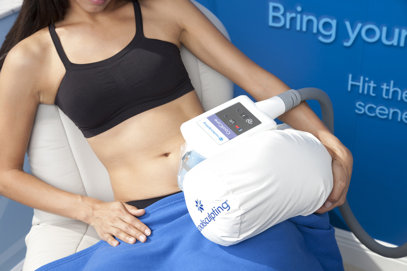 woman getting a coolsculpting procedure done