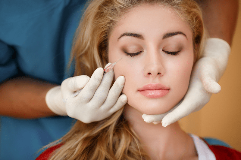 Woman undergoing botox injection