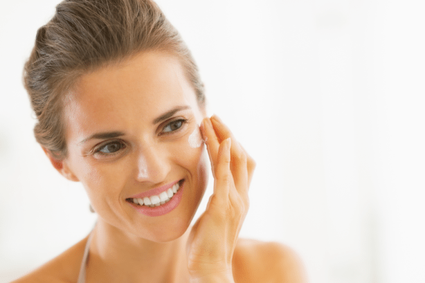 Lady applying skin care products